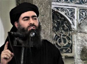 This file image is from video on a militant website July 2014 shows the leader of the Islamic State Abu Bakr al Baghdadi delivering a sermon in Iraq Militant video via AP File