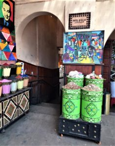 Mellah shop selling art powders and the symbolic salt behind the name of the quarter .