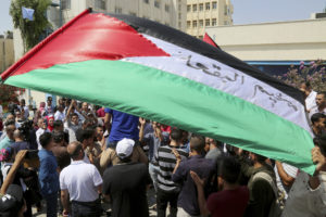 Palestinians protests in Amman Jordan condemning the U.S. decision to end its decades of funding for the U.N. agency for Palestinian refugees. AP Photo Sept. 2 2018 Raad Adayleh