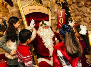 122519 BODY Santa Claus greeting children in Jerusalem Dec. 19 2018 Photo David Vaaknin for the Wash. Post