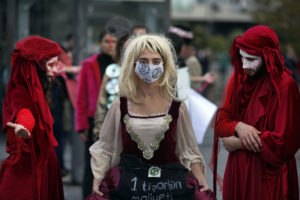 Extinction Rebellion climate change protesters stage an event against the fashion industry in Istanbul Nov. 29 2019. AP Photo Lefteris Pitarakis