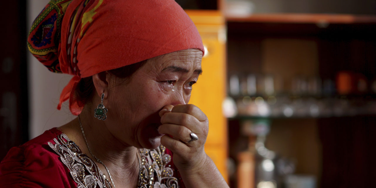 In this Dec. 8 2018 photo Mainur Medetbek cries as she speaks about her husbands detainment in a Chinese interment camp during an interview in a village near Almaty Kazakhstan.