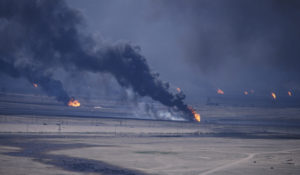 Kuwaits oil wells burning after the defeated Iraqi troops were expelled from Kuwait. March 2 1991. AP Photo Gustavo Ferrari File