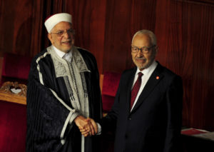 Outgoing National Assembly speaker Abdelfattah Mourou left with new house speaker Rached Ghannouchi during the 1st session of the chamber Nov.13 2019 in Tunis. AP PhotoHassene Dridi