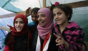 Yemeni activist Tawakkul Karman one of three recipients of the 2011 Nobel Peace Prize is seen with her children inside her tent in Change Square in Sanaa Yemen Saturday Oct. 8 2011.