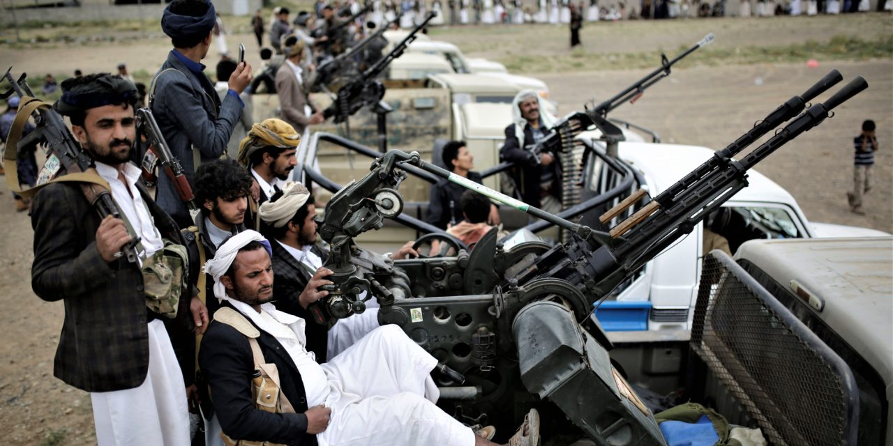Houthi rebel fighters ride on trucks mounted with weapons during a gathering in Sanaa Yemen Thursday Aug. 1 2019.