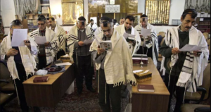 Iranian Jewish men pray during Hanukkah celebrations at the Yousefabad Synagogue in Tehran Iran on Dec. 27 2011