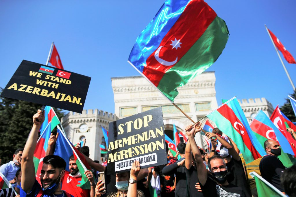 Demonstrators holding Turkish and Azerbaijani flags chant slogans during a protest supporting Azerbaijan in Istanbul Oct. 4 2020. AP PhotoEmrah Gurel 1